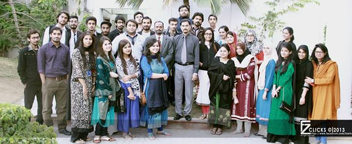 Asif Iqbal in a Group Photograph in Iqra University After Successful Completion of Course